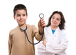 Cute boy tries to use stethoscope of female doctor