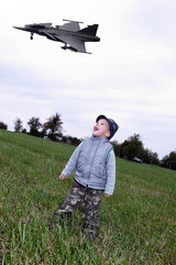 Child on meadows with fighter