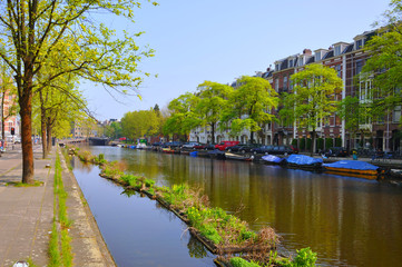 Beautiful river with boats in Amsterdam, Holland (Netherlands)