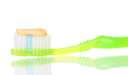 Toothbrush with paste isolated on white