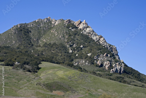 Rocky Hilltop against Blue Sky
