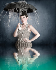 Pin-up girl with umbrella under water splash with river reflecti