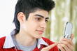 Text messaging teenage boy with mobile phone