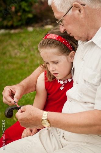 Happy retirement - grandparent with grandchild
