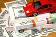 The money euro and dollars and small  automobile