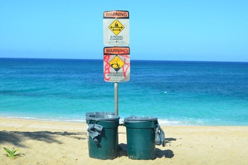 Beach hazard signs and dustbins