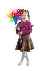 Nice child holding a wind toy