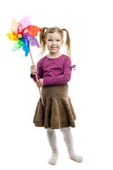 young girl holding a pinwheel