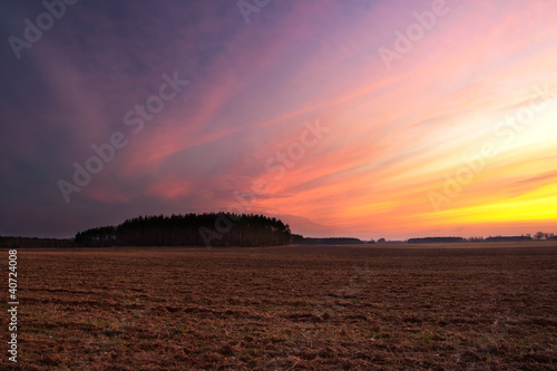 Plowed field after sunset