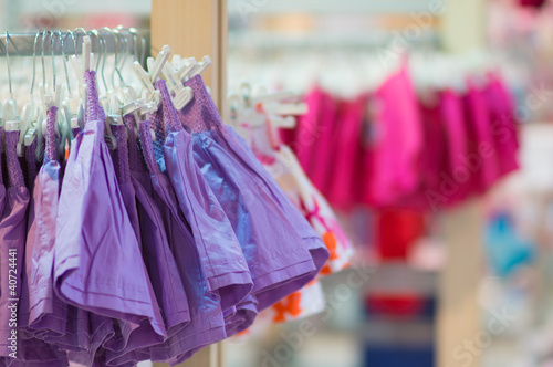 Stands with clothes in kids mall