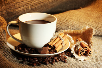cup of coffee and beans, cinnamon sticks and chocolate