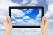 Touch screen device with blue sky in woman hands