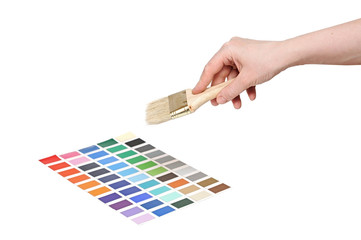 hand with brush and colorful paint samples