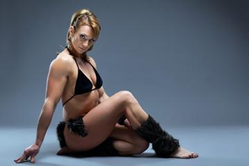 Heavy female body builder in amazon fur costume