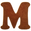 Leather alphabet. Leather textured letter M