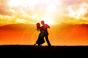 Silhouette illustration of a couple dancing during sunrise