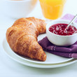 Croissant and Raspberry Jam on a Plate