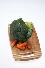 brocolli and carrots on the cutting board
