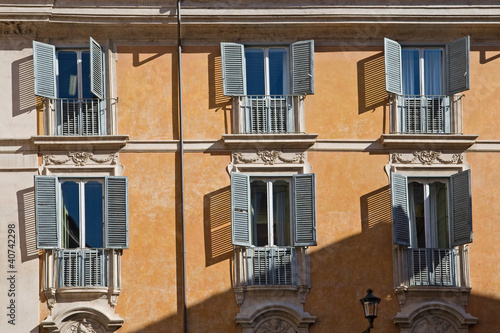 typical italian facade with windows, rome, italy