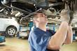 auto mechanic at car suspension repair work - 40745846