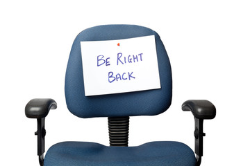 Office chair with a BE RIGHT BACK sign isolated on white