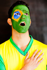 Brazilian man singing anthem