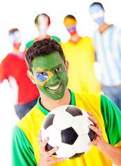 Brazilian football fan with a group