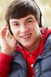 Teenage Boy Wearing Headphones And Listening To Music Wearing Wi
