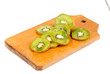 slice of kiwi fruit on  cutting board isotated on a white