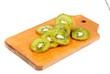 slice of kiwi fruit on  cutting board isotated on a white