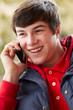 Teenage Boy Talking On Smartphone Wearing Winter Clothes
