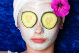 Fototapety Cucumbers on the eyes with a facial mask