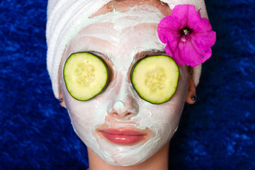 Spa Treatment with facial mask and cucumbers