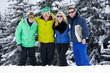 Group Of Young Friends On Ski Holiday In Mountains