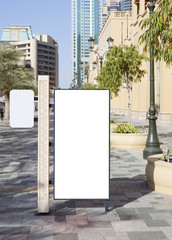 Blank white sign on the city street