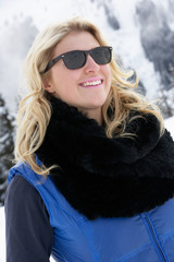 Young Woman On Ski Holiday In Mountains