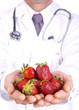 men doctor holding fresh fruit