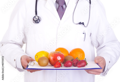 doctor gives fresh fruit