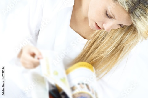 young blond woman reading