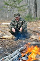 Man at bonfire 3