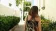 Woman walking outdoor turn around and smile, steadicam shot
