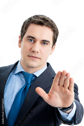 Businessman with stop gesture, on white