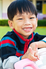 Asian kid playing in Playground