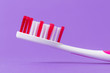 A pink toothbrush