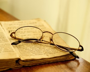Glasses on vintage book.