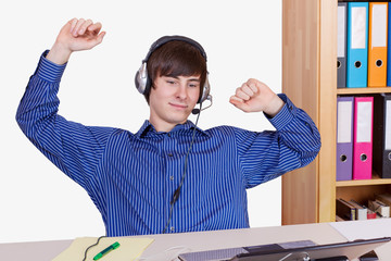 Young Businessman in office with a relaxed music