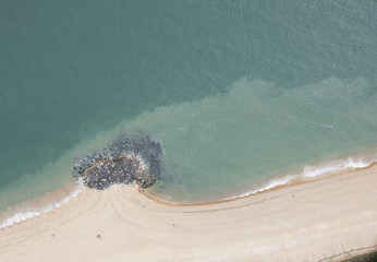 Aerial view of rocky deposits on beach
