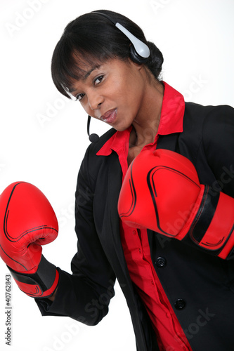 Call-center worker wearing boxing gloves