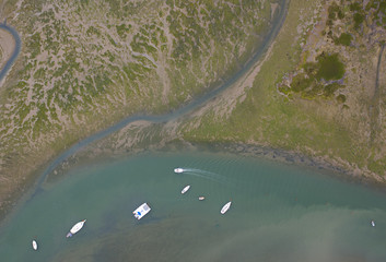 Aerial view of boats in bay and coastline