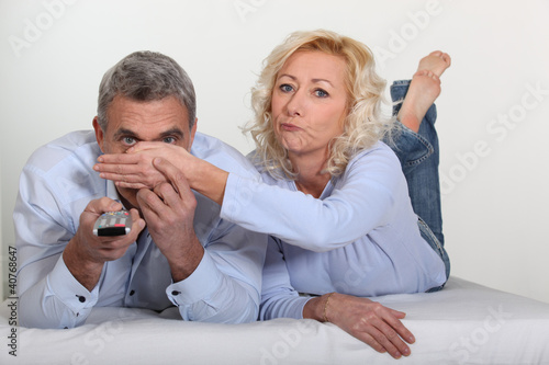 Woman covering her husband's eyes